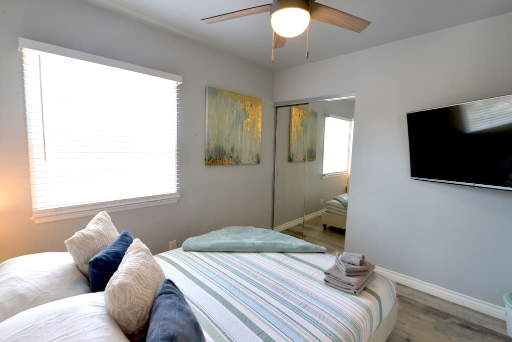 Master Bedroom equipped  with a large TV with Netflix, HULU, & PrimeTV.