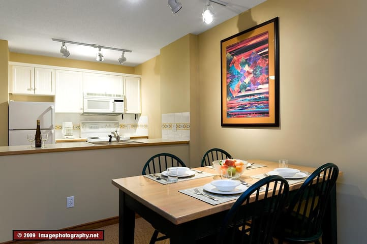The dining area and kitchen. The kitchen is fully equipped for everything from a cup of coffee to a wonderful dinner.