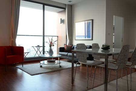 Brand-new, 65 sqm, modern condominium, with 2-bedrooms. Ideal for 3,  a couple alone or with max. 2 children. The 2nd bedroom can be also used as your office, it is equipped with a desk including LED Monitor and a comfortable sofa bed. The next BTS s
