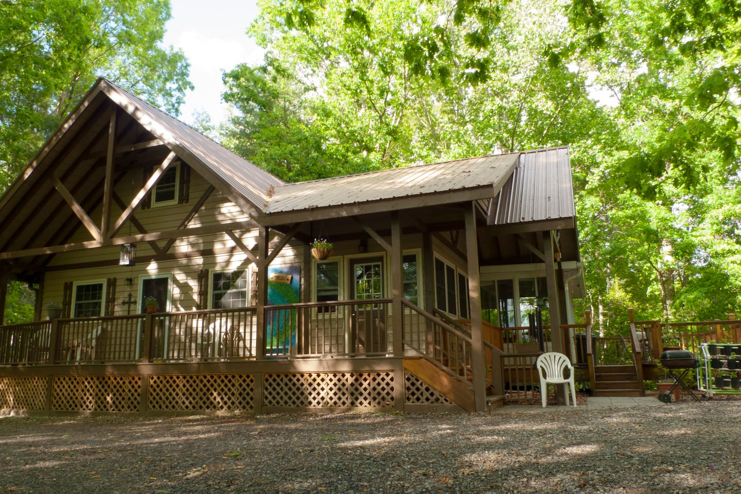 The guest entrance is the door to the left.  There is a covered front porch and a deck overlooking a firepit.