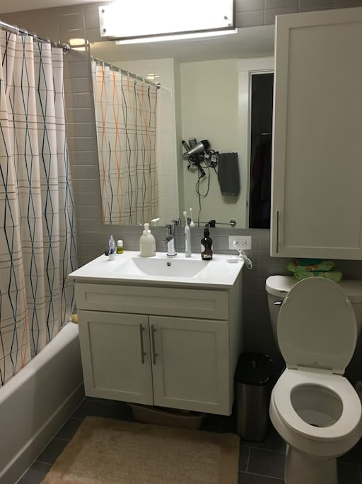 bathroom with shower and tub, medicine cabinet