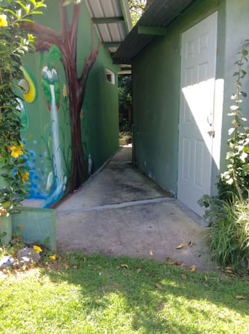 The cement walkway to the casita entry is in 2 sections, total 33', no stairs. This is the first section where it meets the grass. At the end of this walk, you turn left to the casita entry with no stairs.