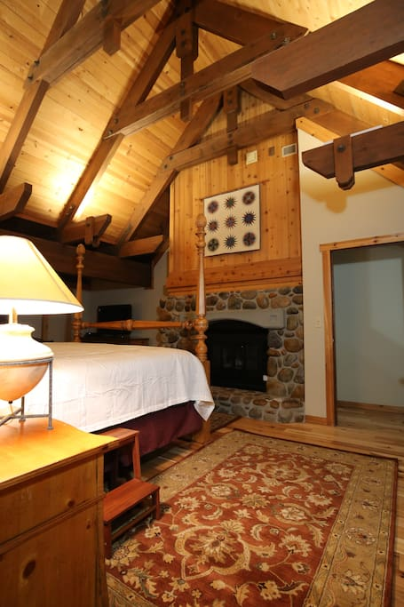 Master Bedroom with fireplace and beam ceiling