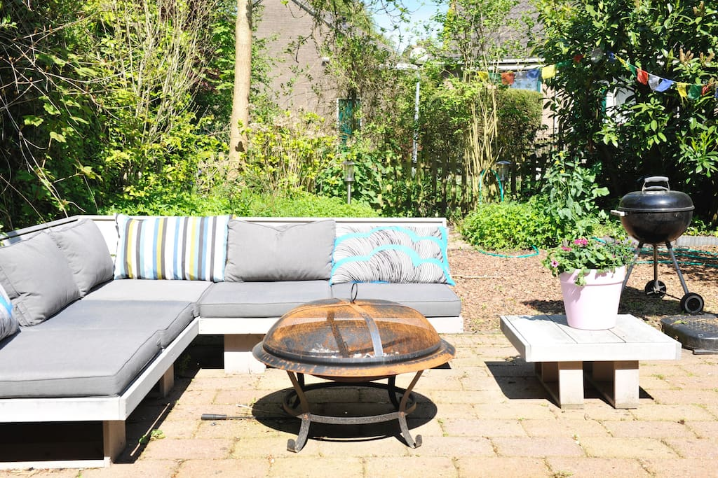 Sunny private garden with lounge set