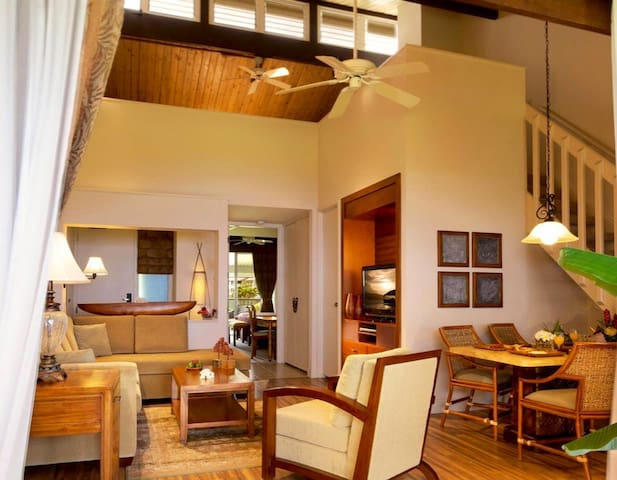 Living room with vaulted ceiling to loft