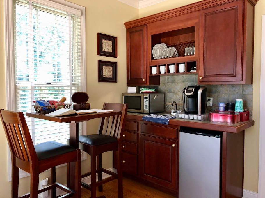 Kitchenette with dining table/workspace.