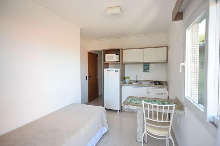 Apartamento Premier com sacada com vista mar