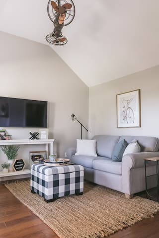 The living room features a SmartTV so you can log into your own accounts. The floors have in-floor heating and provided is a sleeper love seat that converts into a double bed. All decor and furniture in the suite is new as of June 2019.