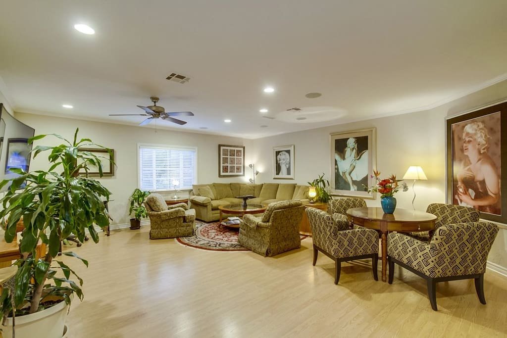 Large spacious living room with game table, media desk, hi-speed internet.