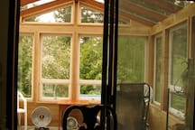 Our Beautiful Sun Room - a great place to hang out or enjoy a cup of coffee or tea