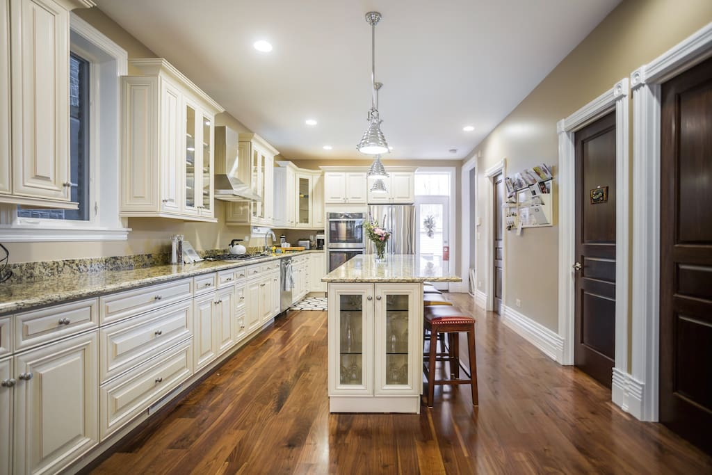 Fully equipped kitchen and access to the walk out deck and grill.