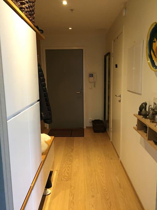 Hallway with a door to the bathroom