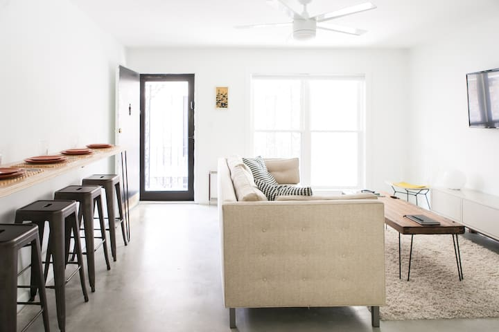 Our condo is bright and airy with large windows, bar seating for four, and a huge comfortable couch!