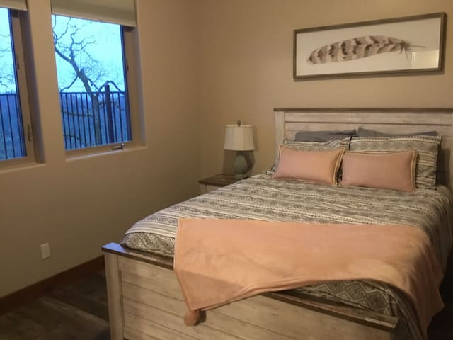 Second downstairs suite guest room with queen memory foam mattress.
