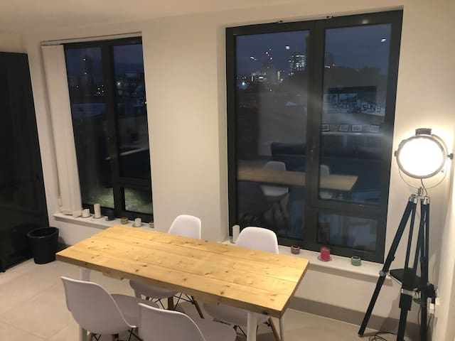 Dining table with views of the Olympic Park and Stratford