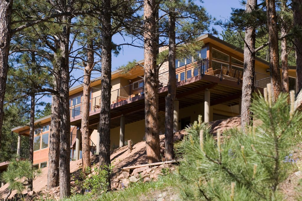 5800 square feet of custom designed living space surrounded by trees, but just minutes from Boulder.