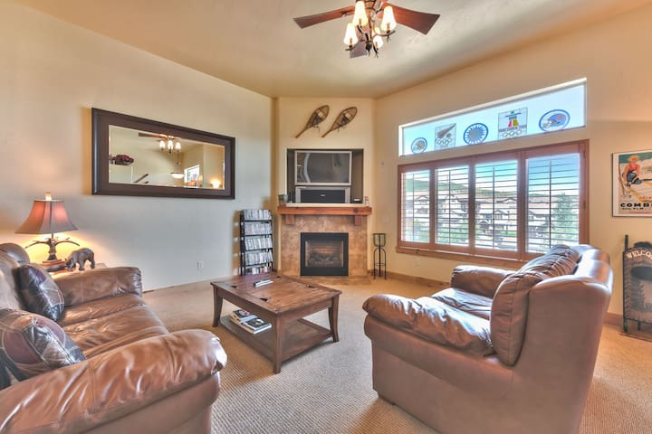 "Main Level Living Room with Comfortable Furnishings, 42"" TV and Gas Fireplace"