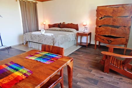 King size bed for 2 people and modern Mexican rustic wood furniture.