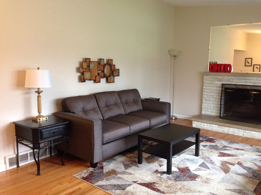 Large living room on the main floor, with vaulted ceilings, fireplace, new comfy sofa and extra seating.