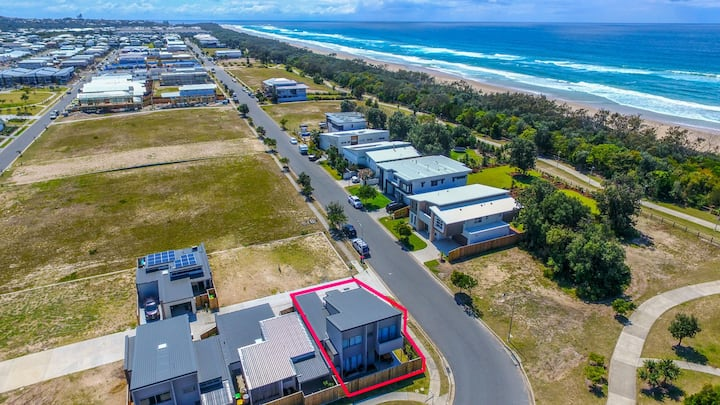 Brand new town house in Casuarina right across from the beach.
