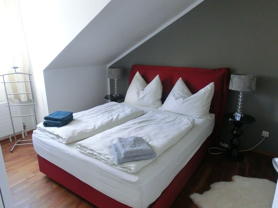 A comfortable box spring-bed in the master bed room