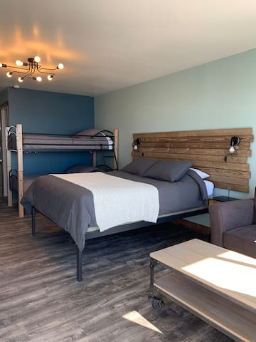 Queen bed and twin bunk beds sleep 4 comfortably.