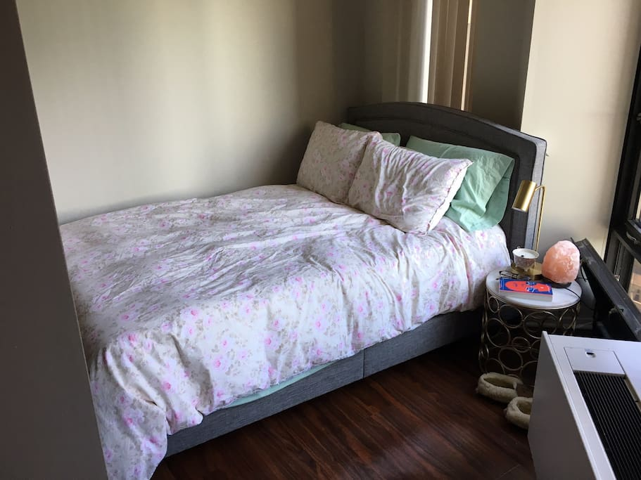semi-private bedroom (1/2 wall separating bedroom from living room)
