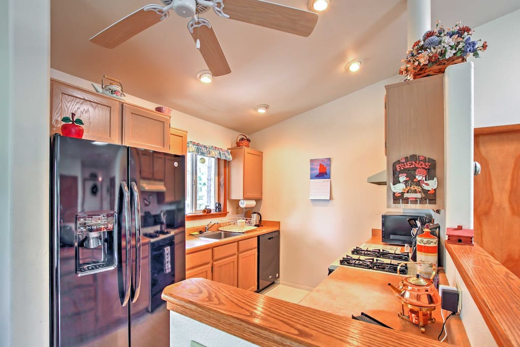 Prepare a home-cooked meal in the fully equipped kitchen, then gather around the dining table set for 4 next to the sliding glass door which leads out to the deck.
