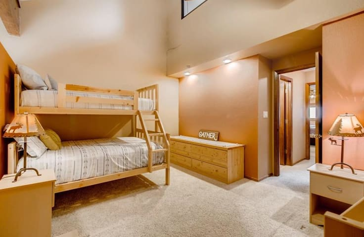 2nd BR with the 2 large bunk beds and view to hallway (2 Full beds over 2 Twin beds)