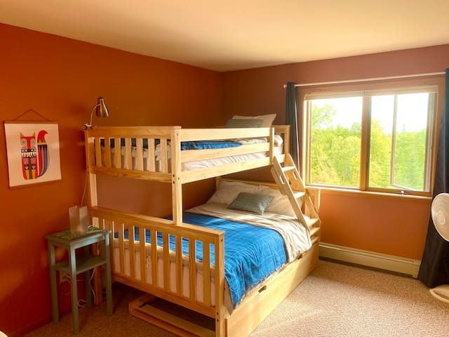 Our bunk bed room offers space for up to four people, with a full bed, a twin bunk, and a twin trundle bed.