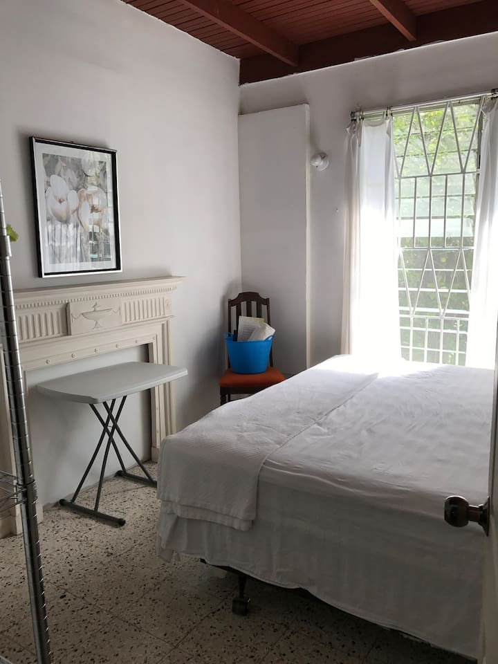 Cozy bedroom. Air-conditioned. King size bed. Clothing rack. Cable TV.  Great WiFi reception in the room.