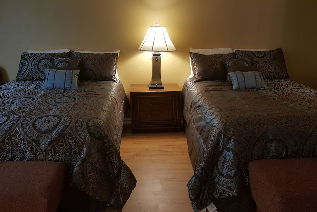 This large Family Suite features two super comfortable premium Queen-size Beds.