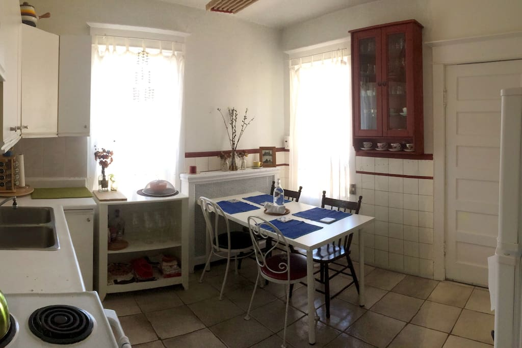 Kitchen with table that can be used as workspace.