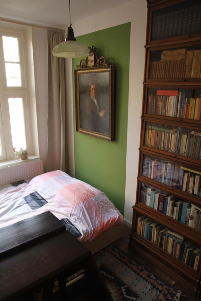 Your room in double bed mode. And yes that's our ancestor Gerrit from the 17th century.