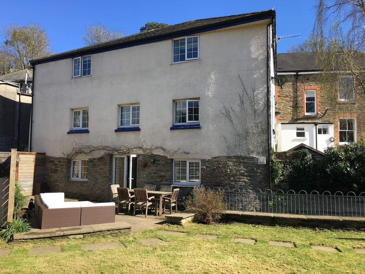Rear of house with patio and garden furniture.