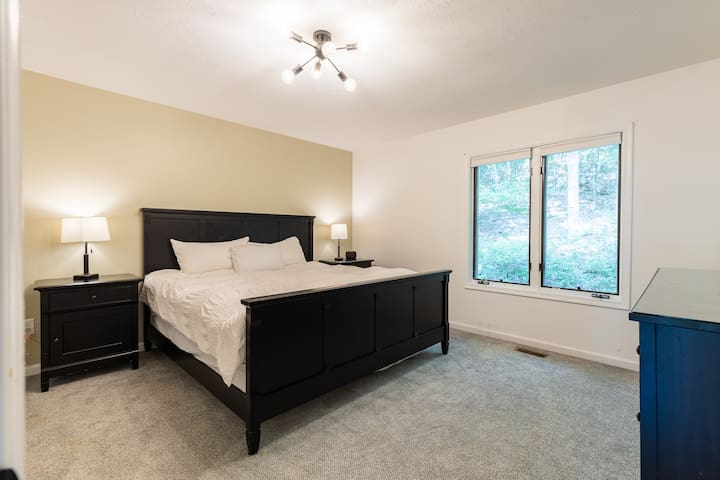 The master bedroom has a large king bed with super comfy pillows, mattress, and goose down comforter.  A large closet and dresser are available for your clothes.  The master suite also has an attached bathroom with full shower, toilet, and sink.