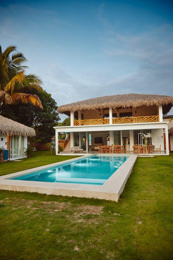 Villa VIKARA-  BEACHFRONT in Olon with a pool.