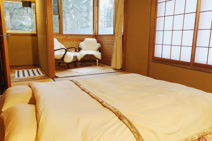 Double futon bed, with reading/sitting nook with views of the forest