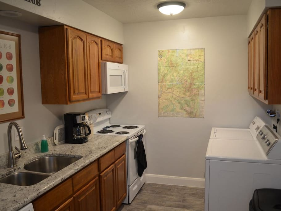 Kitchen with washer and dryer.