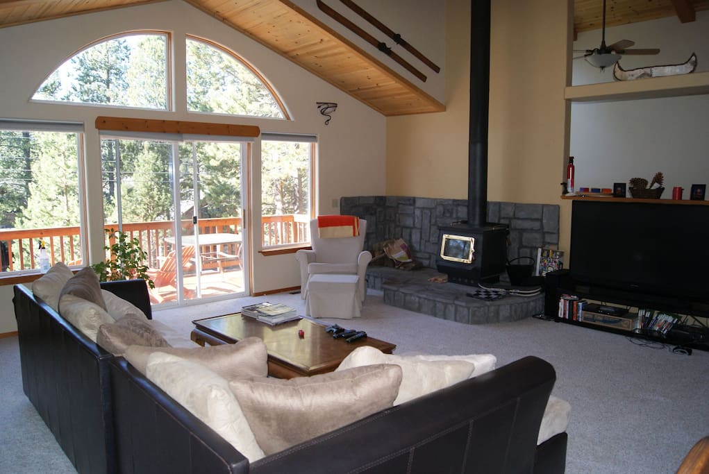 """Living Room w/Wood Burning Stove and 60"""" TV"""