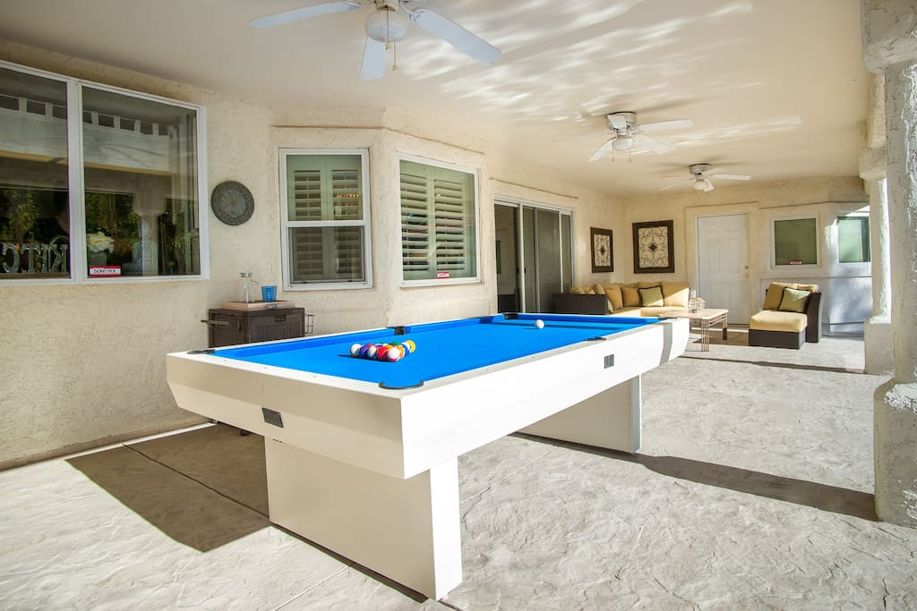 Immaculate backyard w/ heated spa, pool, BBQ, cable TV, basketball court, pool table and plenty of seating.