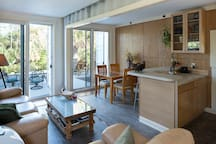 Airy kitchen and living area overlooking the river