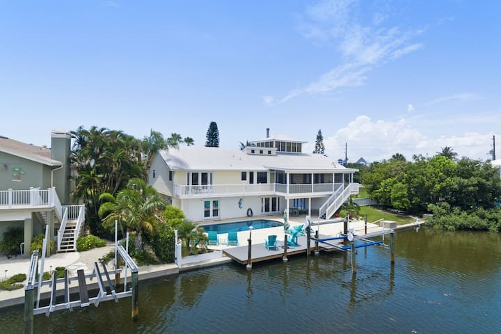 New listing! Canal front island gem w/ private pool, dock, & ping-pong table!