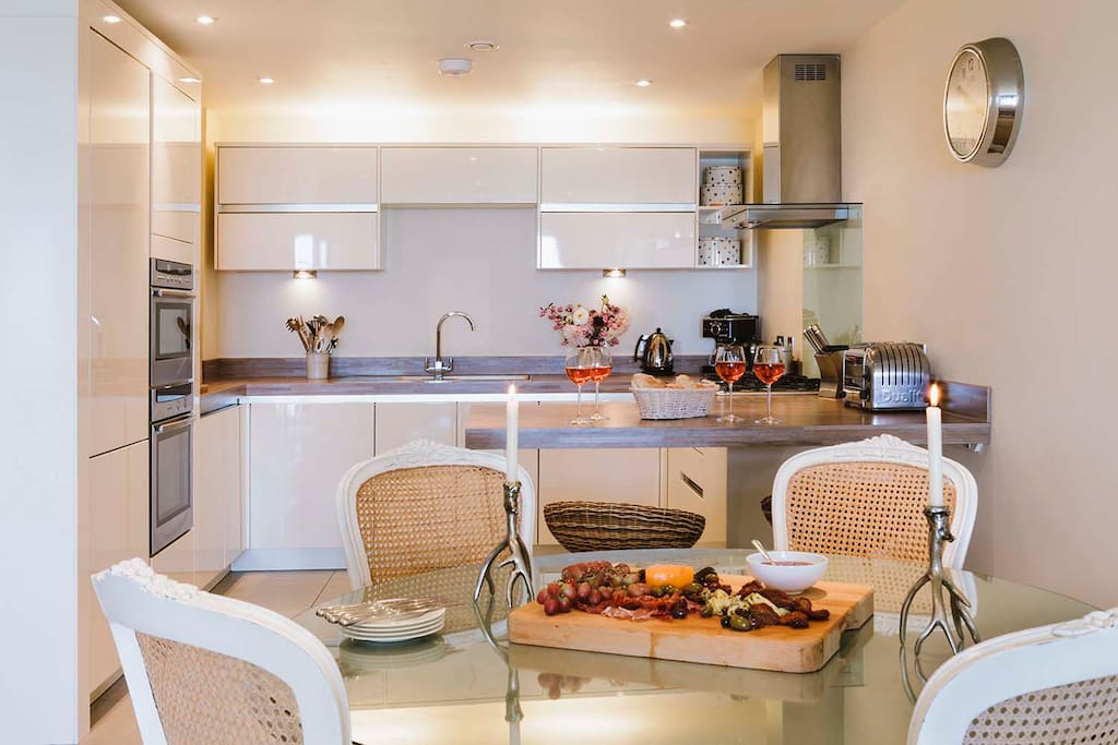 Open plan dining and kitchen area with all the mod cons you may need during your stay