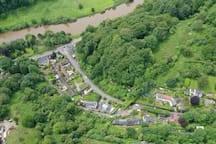 Aerial view showing the River Wye, with the cottage in the bottom right hand corner of the photo.