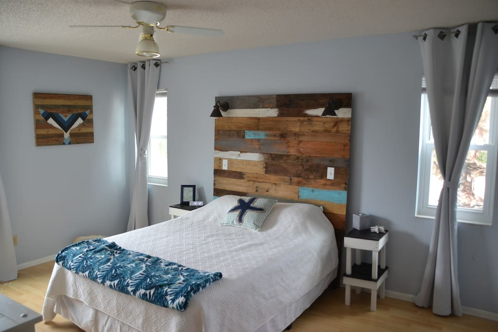 Comfortable Master Bedroom with queen bed, flat screen TV and tech charging station