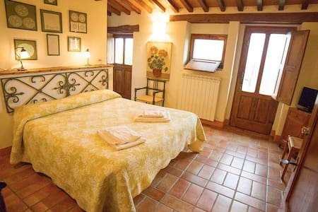 Room with pool view in Podere Pietreta
