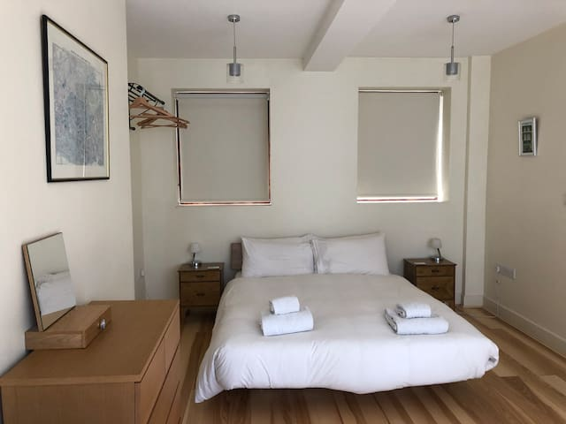 Master Bedroom on 1st Floor with king size bed, TV and ensuite shower