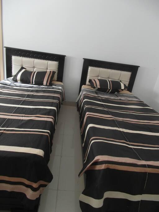 Chambre avec 2 lits séparés