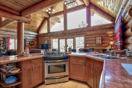 Beautiful Log Home on 6 acres with creek